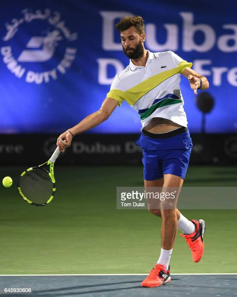 Benoit Paire of France plays a forehand during his match against Roger Federer of Switzerland on day two of the ATP Dubai Duty Free Tennis...