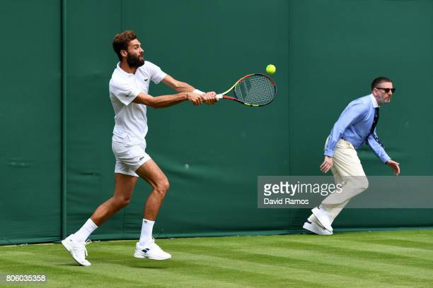 Benoit Paire of France plays a forehand during the Gentlemen's Singles first round match against Rogerio Dutra Silva of Brazil on day one of the...