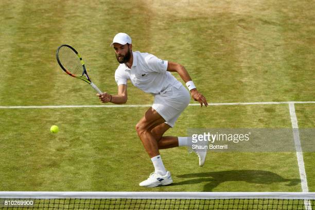 Benoit Paire of France plays a forehand during the Gentlemen's Singles third round match against Jerzy Janowicz of Poland on day five of the...
