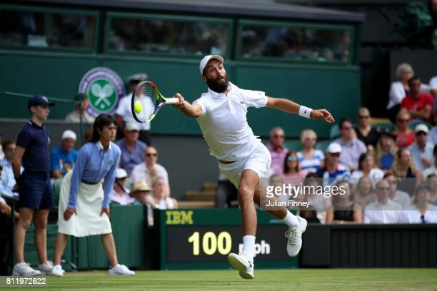 Benoit Paire of France plays a forehand during the Gentlemen's Singles fourth round match against Andy Murray of Great Britain on day seven of the...