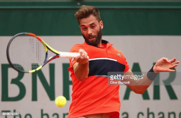 Benoit Paire of France plays a forehand during the mens singles first round match against Rafael Nadal of Spain on day two of the 2017 French Open at...