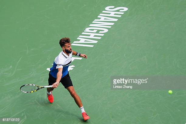 Benoit Paire of France returns a shot against Joao Sousa of Portugal during the Men's singles first round match on day two of Shanghai Rolex Masters...