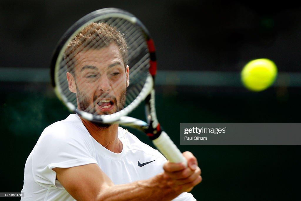 <a gi-track='captionPersonalityLinkClicked' href=/galleries/search?phrase=Benoit+Paire&family=editorial&specificpeople=6999938 ng-click='$event.stopPropagation()'>Benoit Paire</a> of France returns a shot during his Gentlemen's Singles third round match against Brian Baker the USA on day six of the Wimbledon Lawn Tennis Championships at the All England Lawn Tennis and Croquet Club at Wimbledon on June 30, 2012 in London, England.