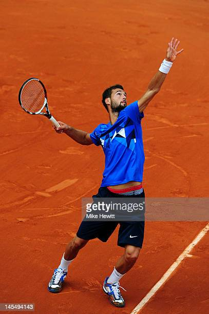 Benoit Paire of France serves during his men's singles second round match against David Ferrer of Spain during day five of the French Open at Roland...