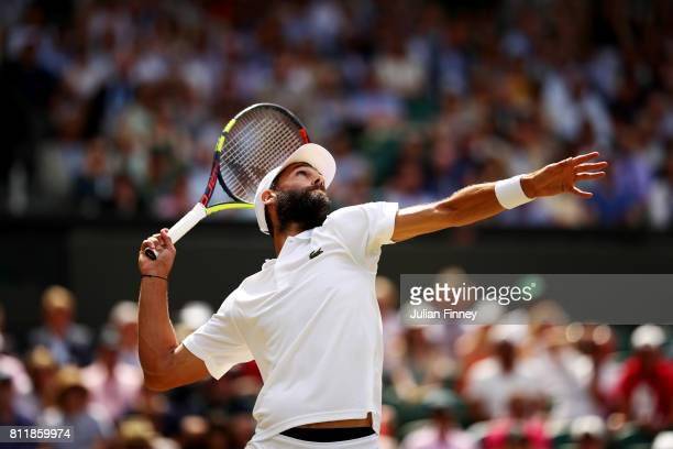 Benoit Paire of France serves during the Gentlemen's Singles fourth round match against Andy Murray of Great Britain on day seven of the Wimbledon...