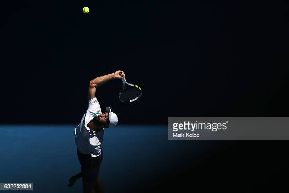 Benoit Paire of France serves in his third round match against Dominic Thiem of Austria on day six of the 2017 Australian Open at Melbourne Park on...