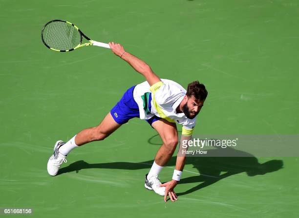 Benoit Paire of France slips after his shot in a straight set loss to Taylor Fritz at Indian Wells Tennis Garden on March 10 2017 in Indian Wells...