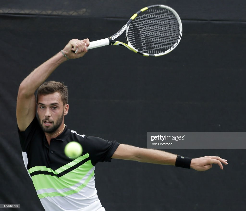 Benoit Paire of France watches his return to James Blake on August 20, 2013 in Winston Salem, North Carolina.
