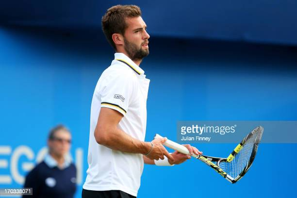 Benoit Paire of France with a broken racket during the Men's Singles second round match against Denis Kudla of the USA on day two of the AEGON...