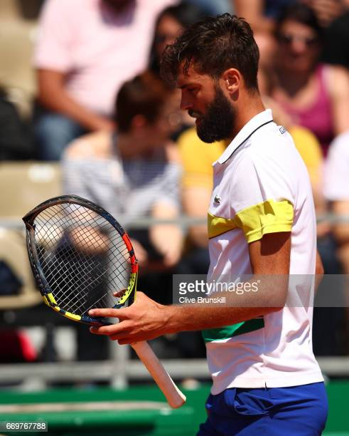 Benoit Paire of France with his smashed racket during his straight sets defeat against Tommy Haas of Germany in his first round match on day three of...