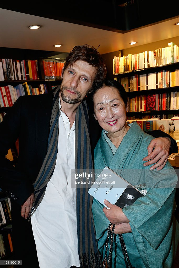 Benoit Peverelli and his stepmother Setsuko Klossowska De Rola, the widow of late painter Balthus attend the book signing of 'Dream Life' (Vie Revee) by Thadee Klossowski De Rola at Galignani Bookstore in Paris, France on March 20, 2013.