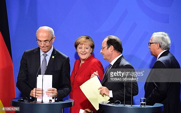 Benoit Potier head of the European round table of Industrialists and CEO of Air Liquide German Chancellor Angela Merkel French President Francois...