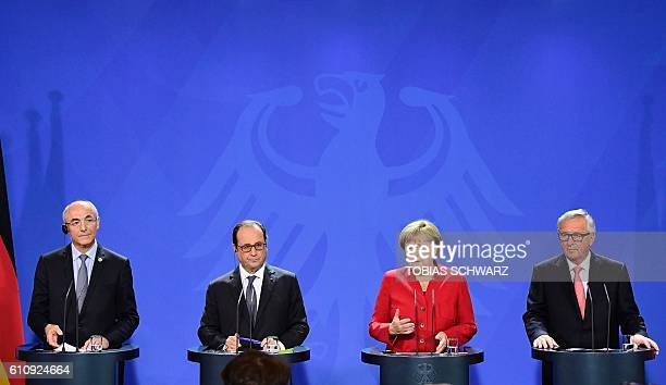 Benoit Potier head of the European round table of Industrialists and CEO of Air Liquide French President Francois Hollande German Chancellor Angela...