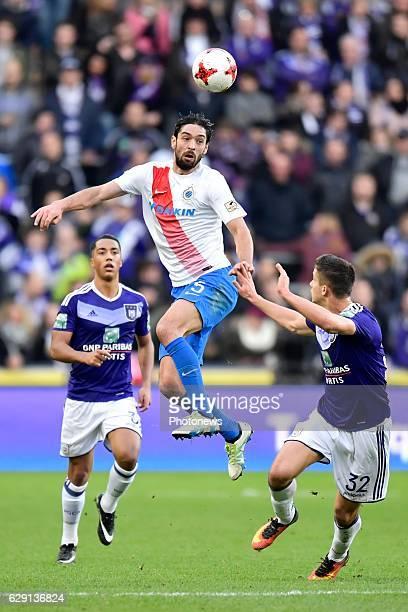 Benoit Poulain defender of Club Brugge jumps up to reach the ball in front of Leander Dendoncker midfielder of RSC Anderlecht during the Jupiler Pro...