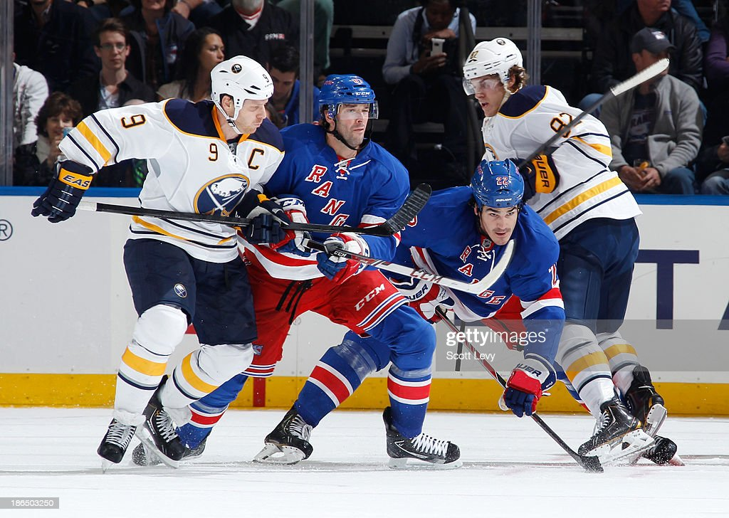 <a gi-track='captionPersonalityLinkClicked' href=/galleries/search?phrase=Benoit+Pouliot&family=editorial&specificpeople=879830 ng-click='$event.stopPropagation()'>Benoit Pouliot</a> #67 and Brian Boyle #22 of the New York Rangers battle for position against <a gi-track='captionPersonalityLinkClicked' href=/galleries/search?phrase=Steve+Ott&family=editorial&specificpeople=210616 ng-click='$event.stopPropagation()'>Steve Ott</a> #9 and <a gi-track='captionPersonalityLinkClicked' href=/galleries/search?phrase=Marcus+Foligno&family=editorial&specificpeople=5662790 ng-click='$event.stopPropagation()'>Marcus Foligno</a> #82 of the Buffalo Sabres in front of the net at Madison Square Garden on October 31, 2013 in New York City.
