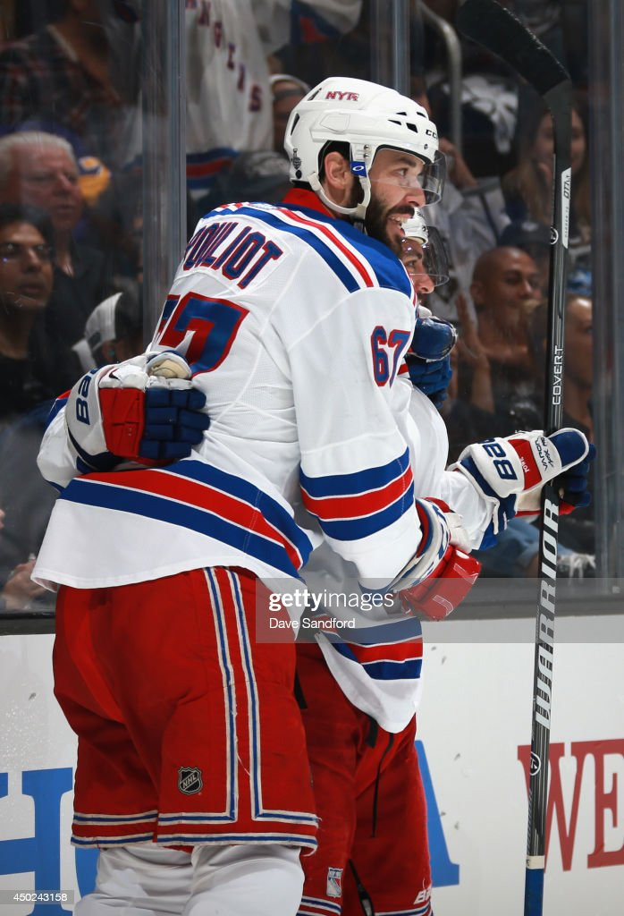 <a gi-track='captionPersonalityLinkClicked' href=/galleries/search?phrase=Benoit+Pouliot&family=editorial&specificpeople=879830 ng-click='$event.stopPropagation()'>Benoit Pouliot</a> #67 and <a gi-track='captionPersonalityLinkClicked' href=/galleries/search?phrase=Derick+Brassard&family=editorial&specificpeople=540468 ng-click='$event.stopPropagation()'>Derick Brassard</a> #16 of the New York Rangers celebrates Mats Zuccarello's goal in the first period of Game Two of the 2014 Stanley Cup Final at Staples Center on June 7, 2014 in Los Angeles, California.