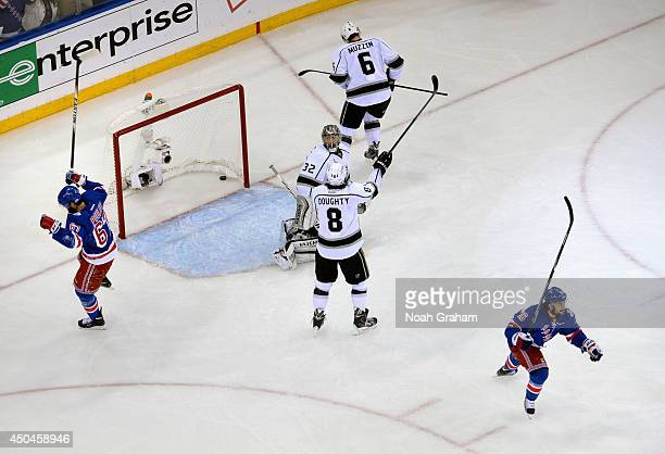 Benoit Pouliot and Mats Zuccarello of the New York Rangers celebrate as goaltender Jonathan Quick Drew Doughty and Jake Muzzin of the Los Angeles...