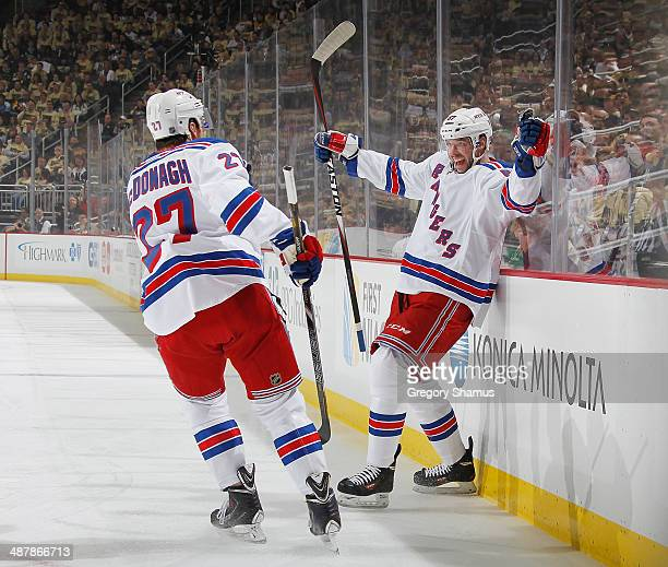Benoit Pouliot celebrates his goal with Ryan McDonagh of the New York Rangers during the first period against the Pittsburgh Penguins in Game One of...