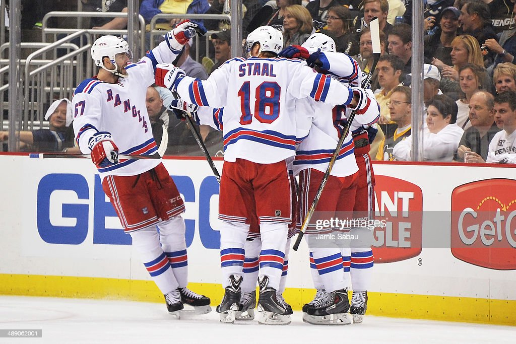 Benoit Pouliot #67, Marc Staal and Derick Brassard #16 of the New York Rangers celebrate after Brassard scored his second goal of the game in the second period against the Pittsburgh Penguins in Game Five of the Second Round of the 2014 NHL Stanley Cup Playoffs on May 9, 2014 at CONSOL Energy Center in Pittsburgh, Pennsylvania.