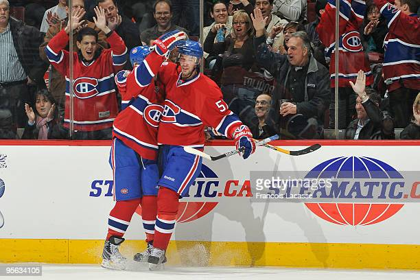 Benoit Pouliot of Montreal Canadiens celebrates with teammate Scott Gomez the first goal of the game against Florida Panthers on January 7 2010 at...