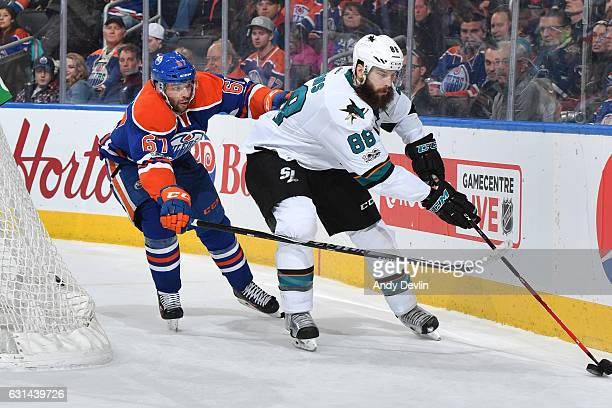 Benoit Pouliot of the Edmonton Oilers battles for the puck against Brent Burns of the San Jose Sharks on January 10 2017 at Rogers Place in Edmonton...