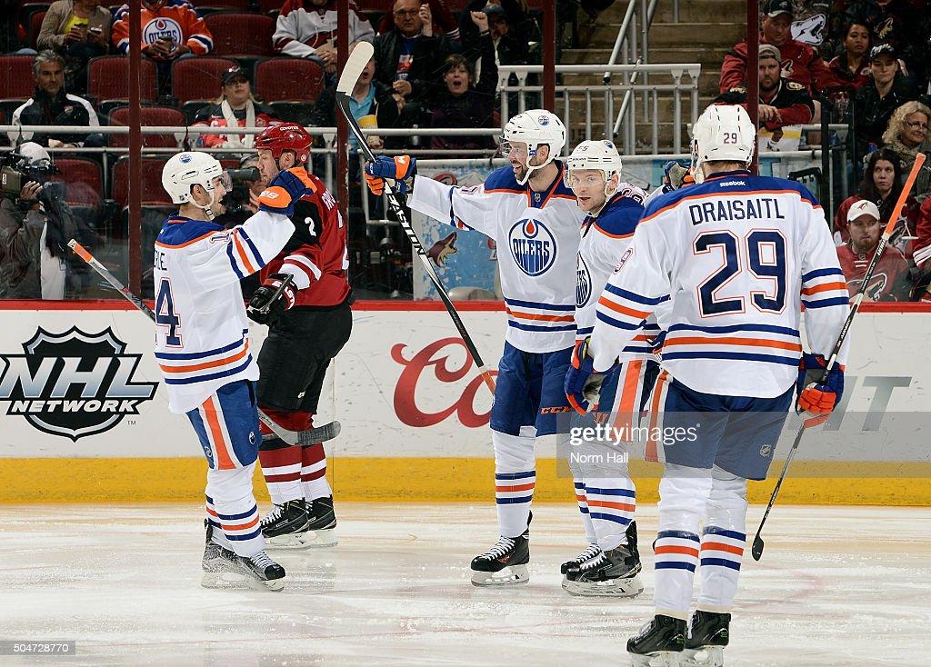 Benoit Pouliot of the Edmonton Oilers celebrates with teammates Jordan Eberle and Mark Letestu after his goal against the Arizona Coyotes as Leon...