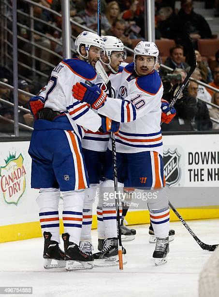 Benoit Pouliot of the Edmonton Oilers Nail Yakupov of the Edmonton Oilers and Leon Draisaitl of the Edmonton Oilers react to a goal scored against...