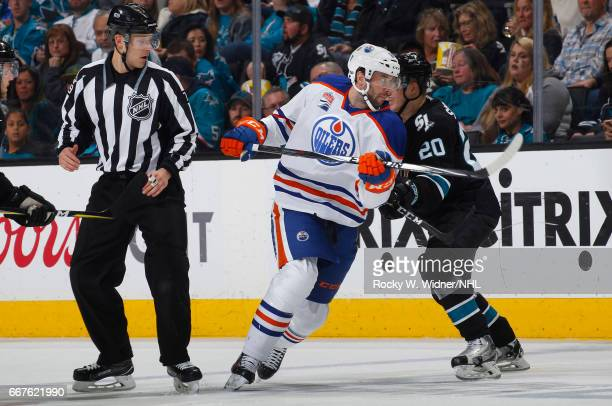 Benoit Pouliot of the Edmonton Oilers skates against Marcus Sorensen of the San Jose Sharks at SAP Center on April 6 2017 in San Jose California
