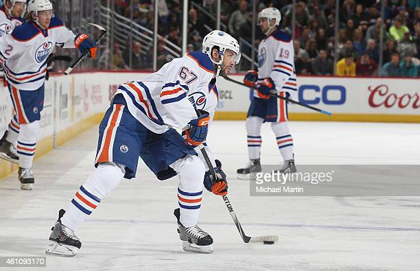 Benoit Pouliot of the Edmonton Oilers skates against the Colorado Avalanche at the Pepsi Center on January 2 2015 in Denver Colorado The Avalanche...