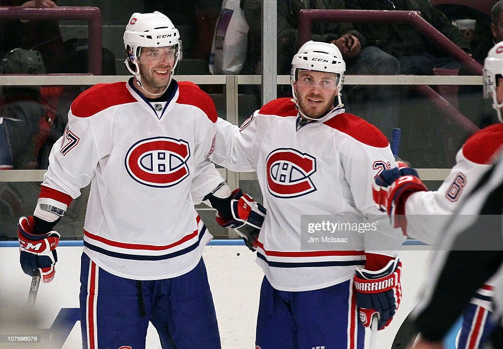 Benoit Pouliot of the Montreal Canadiens celebrates his thirdperiod goal against the New York Rangers with teammate James Wisniewski on January 11...