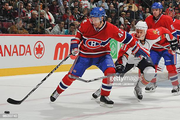 Benoit Pouliot of the Montreal Canadiens skates with the puck in front of Shawn Matthias of the Florida Panthers during the NHL game on March 25 2010...