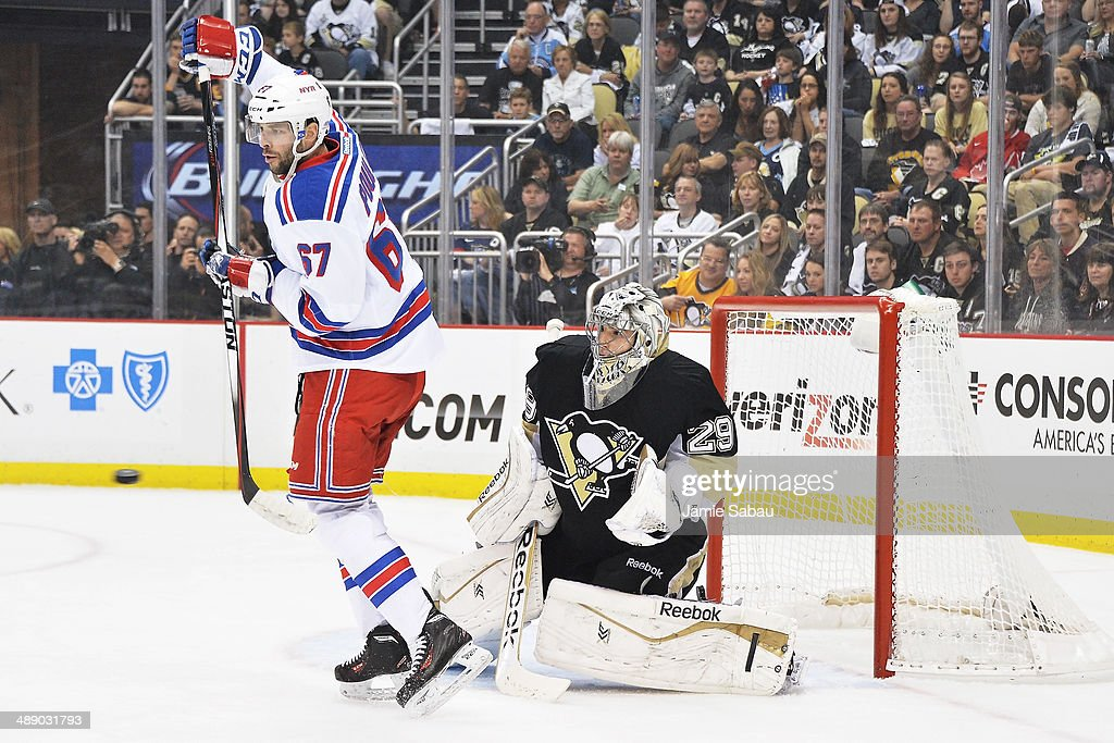 Benoit Pouliot #67 of the New York Rangers attempts to redirect an incoming shot on goaltender Marc-Andre Fleury #29 of the Pittsburgh Penguins in the first period in Game Five of the Second Round of the 2014 NHL Stanley Cup Playoffs on May 9, 2014 at CONSOL Energy Center in Pittsburgh, Pennsylvania.