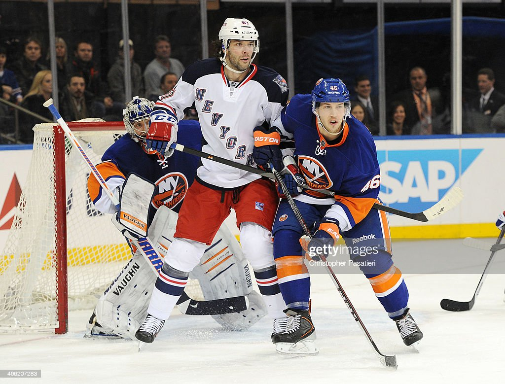 <a gi-track='captionPersonalityLinkClicked' href=/galleries/search?phrase=Benoit+Pouliot&family=editorial&specificpeople=879830 ng-click='$event.stopPropagation()'>Benoit Pouliot</a> #67 of the New York Rangers battles for position against Matt Donovan #46 of the New York Islanders during the third period on January 31, 2014 at Madison Square Garden in New York City.