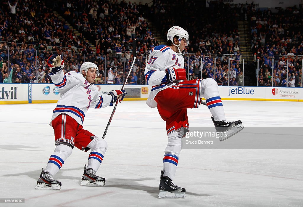 <a gi-track='captionPersonalityLinkClicked' href=/galleries/search?phrase=Benoit+Pouliot&family=editorial&specificpeople=879830 ng-click='$event.stopPropagation()'>Benoit Pouliot</a> #67 of the New York Rangers celebrates his game winning goal at 13:46 of the third period against the New York Islanders at the Nassau Veterans Memorial Coliseum on October 29, 2013 in Uniondale, New York. The Rangers defeated the Islanders 3-2.