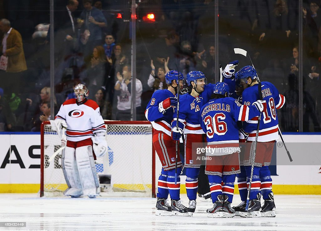 Benoit Pouliot #67 of the New York Rangers celebrates his goal against Cam Ward #30 of the Carolina Hurricanes with his team during their game at Madison Square Garden on April 8, 2014 in New York City.