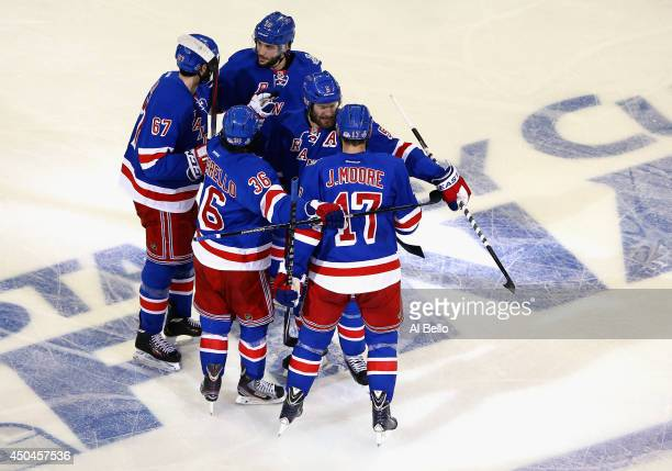 Benoit Pouliot of the New York Rangers celebrates his goal Jonathan Quick of the Los Angeles Kings with his linemates during the first period of Game...