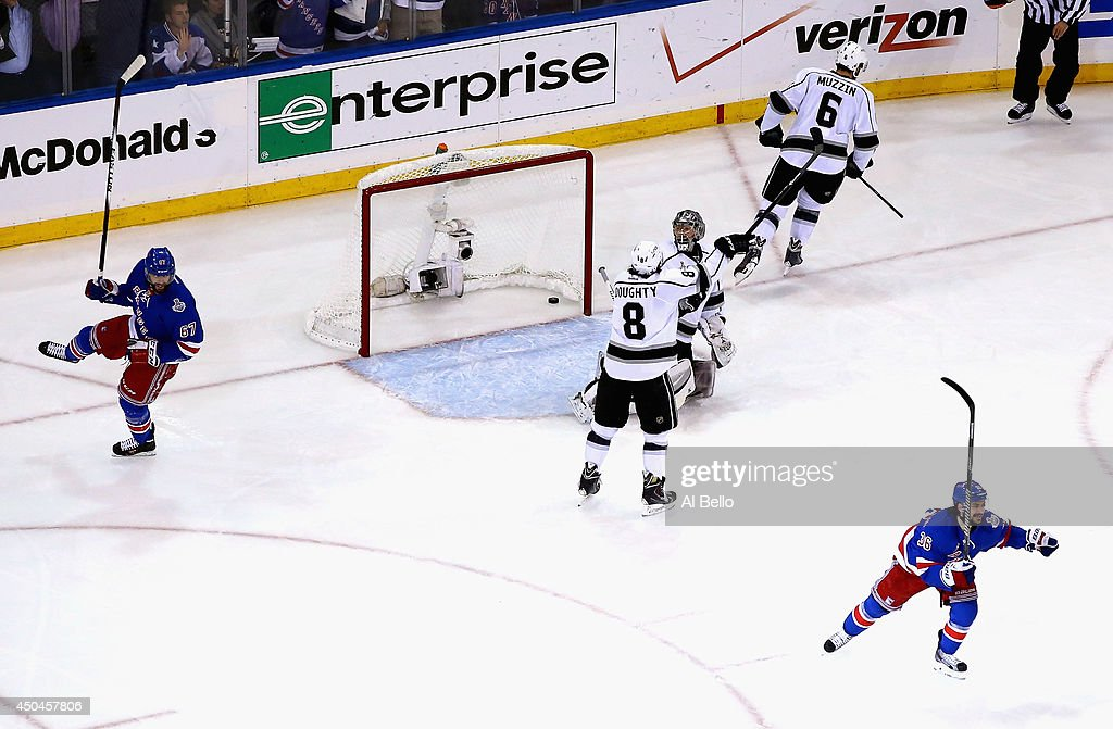 Benoit Pouliot of the New York Rangers celebrates his goal on Jonathan Quick of the Los Angeles Kings during the first period of Game Four of the...