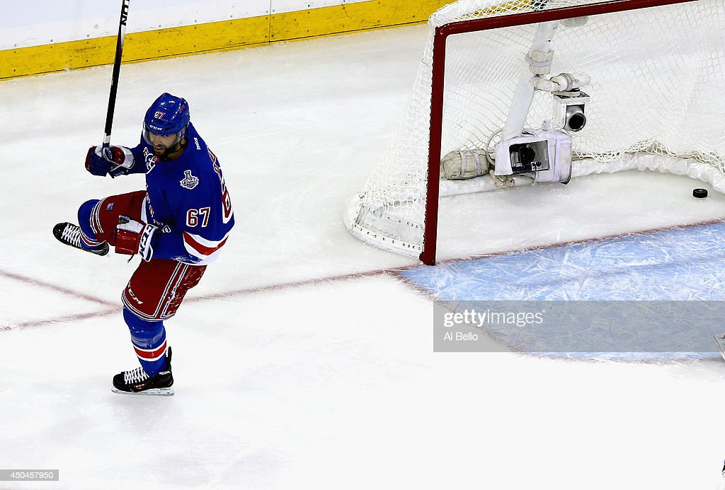 <a gi-track='captionPersonalityLinkClicked' href=/galleries/search?phrase=Benoit+Pouliot&family=editorial&specificpeople=879830 ng-click='$event.stopPropagation()'>Benoit Pouliot</a> #67 of the New York Rangers celebrates his goal on Jonathan Quick #32 of the Los Angeles Kings during the first period of Game Four of the 2014 NHL Stanley Cup Final at Madison Square Garden on June 11, 2014 in New York, New York.