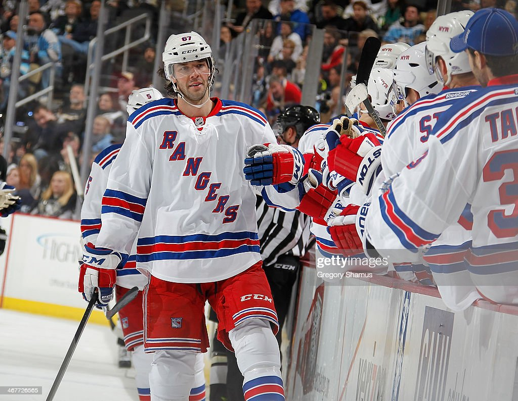 <a gi-track='captionPersonalityLinkClicked' href=/galleries/search?phrase=Benoit+Pouliot&family=editorial&specificpeople=879830 ng-click='$event.stopPropagation()'>Benoit Pouliot</a> #67 of the New York Rangers celebrates his goal with the bench during the third period against the Pittsburgh Penguins on February 7, 2014 at Consol Energy Center in Pittsburgh, Pennsylvania. New York won the game 4-3 in a shootout.