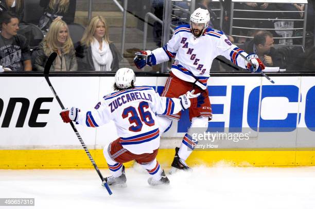 Benoit Pouliot of the New York Rangers celebrates with teammate Mats Zuccarello after Pouliot scores the first goal in the first period against the...