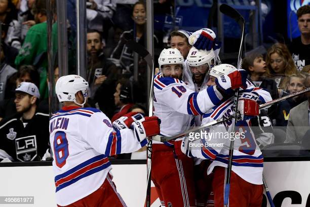 Benoit Pouliot of the New York Rangers celebrates with teammate Derick Brassard Kevin Klein and Mats Zuccarello after Pouliot scores the first goal...