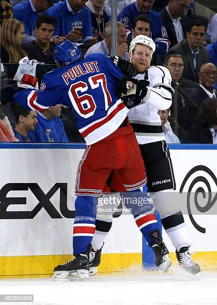 Benoit Pouliot of the New York Rangers checks Jeff Carter of the Los Angeles Kings during the first period of Game Three of the 2014 NHL Stanley Cup...