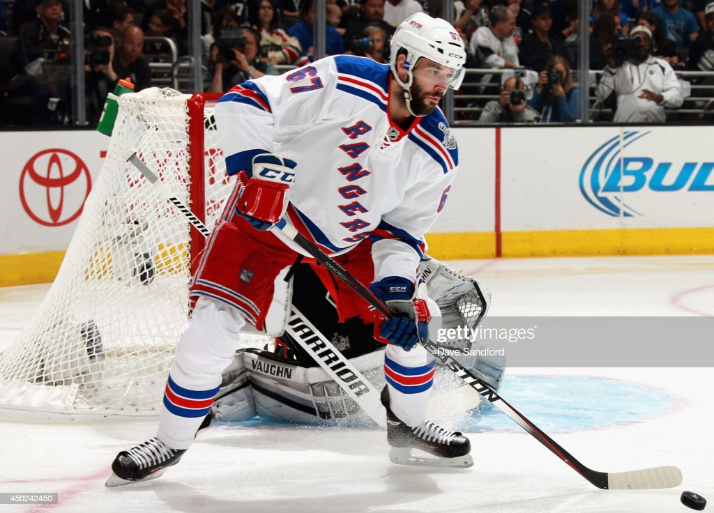 <a gi-track='captionPersonalityLinkClicked' href=/galleries/search?phrase=Benoit+Pouliot&family=editorial&specificpeople=879830 ng-click='$event.stopPropagation()'>Benoit Pouliot</a> #67 of the New York Rangers handles the puck against the Los Angeles Kings during the first period of Game Two of the 2014 Stanley Cup Final at Staples Center on June 7, 2014 in Los Angeles, California.
