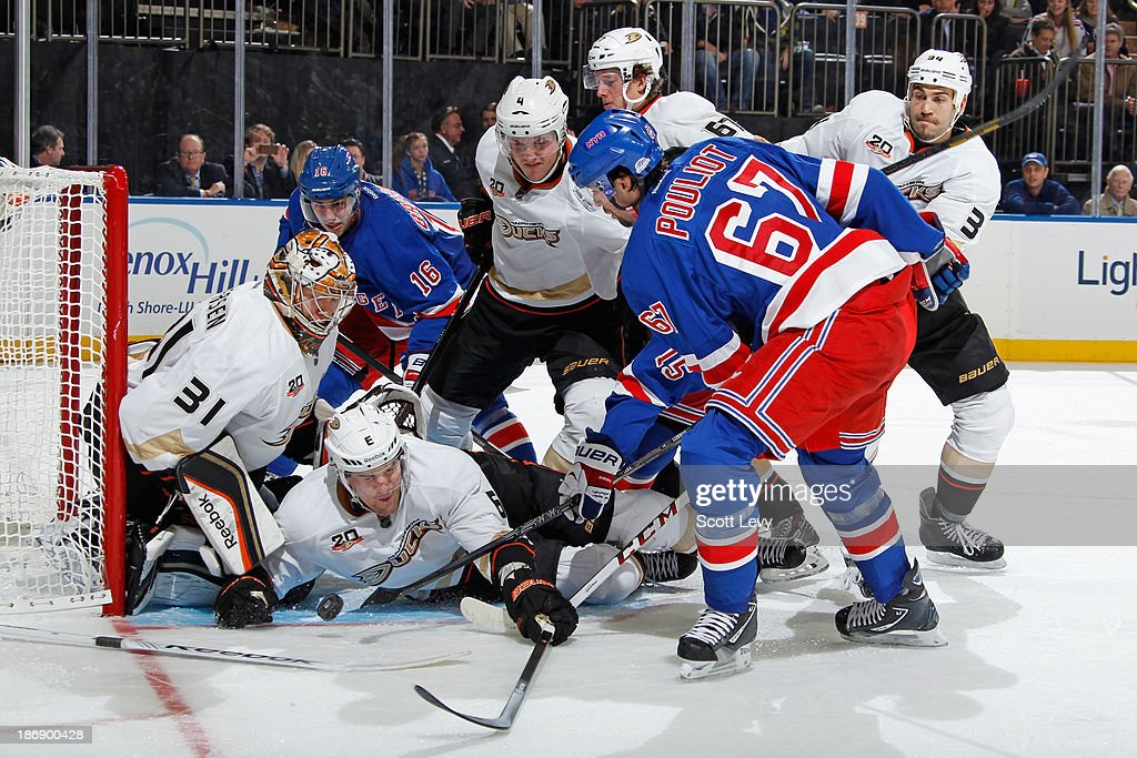 <a gi-track='captionPersonalityLinkClicked' href=/galleries/search?phrase=Benoit+Pouliot&family=editorial&specificpeople=879830 ng-click='$event.stopPropagation()'>Benoit Pouliot</a> #67 of the New York Rangers has his shot blocked by <a gi-track='captionPersonalityLinkClicked' href=/galleries/search?phrase=Ben+Lovejoy&family=editorial&specificpeople=4509565 ng-click='$event.stopPropagation()'>Ben Lovejoy</a> #6 of the Anaheim Ducks in front of the net at Madison Square Garden on November 4, 2013 in New York City.