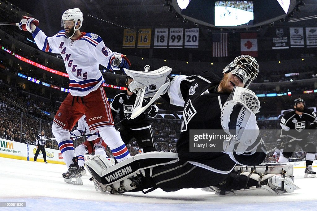 Benoit Pouliot of the New York Rangers runs into goaltender Jonathan Quick of the Los Angeles Kings and is called for goalie interference in the...