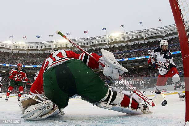 Benoit Pouliot of the New York Rangers scores a second period goal against Martin Brodeur of the New Jersey Devils during the 2014 Coors Light NHL...