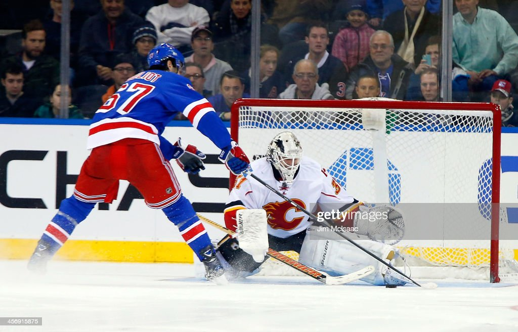 <a gi-track='captionPersonalityLinkClicked' href=/galleries/search?phrase=Benoit+Pouliot&family=editorial&specificpeople=879830 ng-click='$event.stopPropagation()'>Benoit Pouliot</a> #67 of the New York Rangers scores the shoot out winning goal against <a gi-track='captionPersonalityLinkClicked' href=/galleries/search?phrase=Karri+Ramo&family=editorial&specificpeople=716721 ng-click='$event.stopPropagation()'>Karri Ramo</a> #31 of the Calgary Flames at Madison Square Garden on December 15, 2013 in New York City.