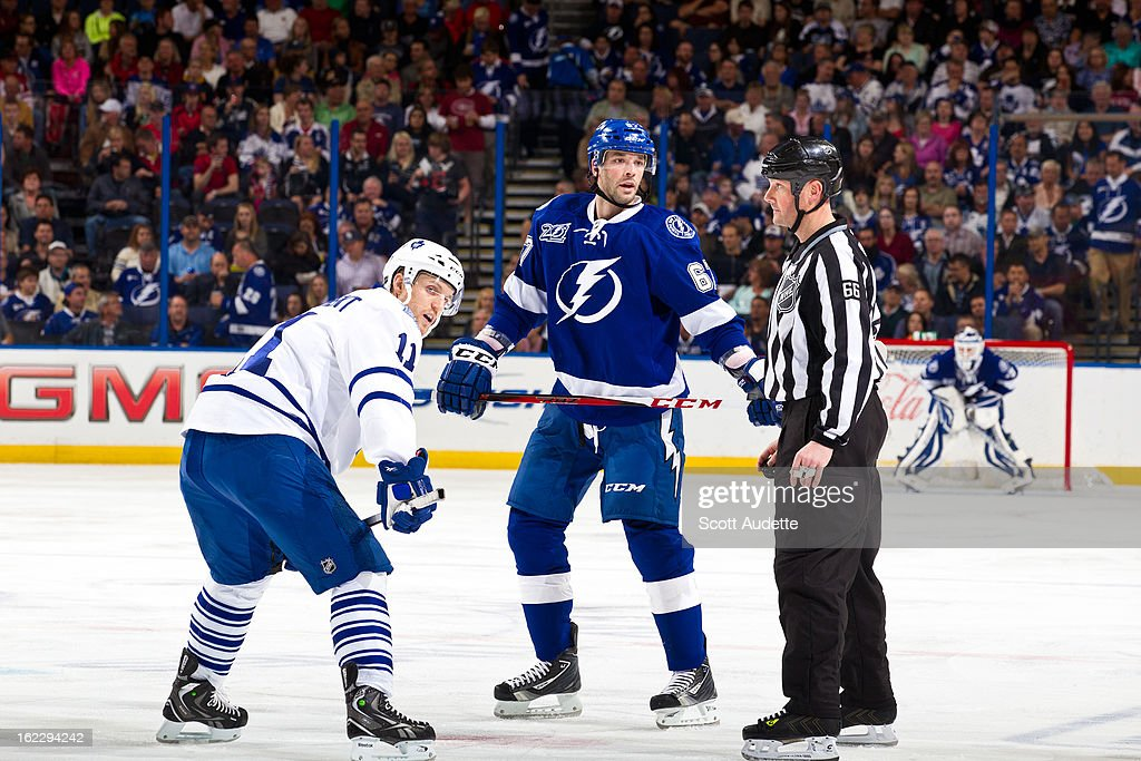 <a gi-track='captionPersonalityLinkClicked' href=/galleries/search?phrase=Benoit+Pouliot&family=editorial&specificpeople=879830 ng-click='$event.stopPropagation()'>Benoit Pouliot</a> #67 of the Tampa Bay Lightning faces off against <a gi-track='captionPersonalityLinkClicked' href=/galleries/search?phrase=Jay+McClement&family=editorial&specificpeople=575233 ng-click='$event.stopPropagation()'>Jay McClement</a> #11 of the Toronto Maple Leafs during the first period of the game at the Tampa Bay Times Forum on February 19, 2013 in Tampa, Florida.