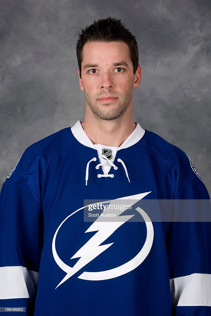 <a gi-track='captionPersonalityLinkClicked' href=/galleries/search?phrase=Benoit+Pouliot&family=editorial&specificpeople=879830 ng-click='$event.stopPropagation()'>Benoit Pouliot</a> #67 of the Tampa Bay Lightning poses for his official headshot for the 2012-2013 season at the Tampa Bay Times Forum on January 13, 2013 in Tampa, Florida.