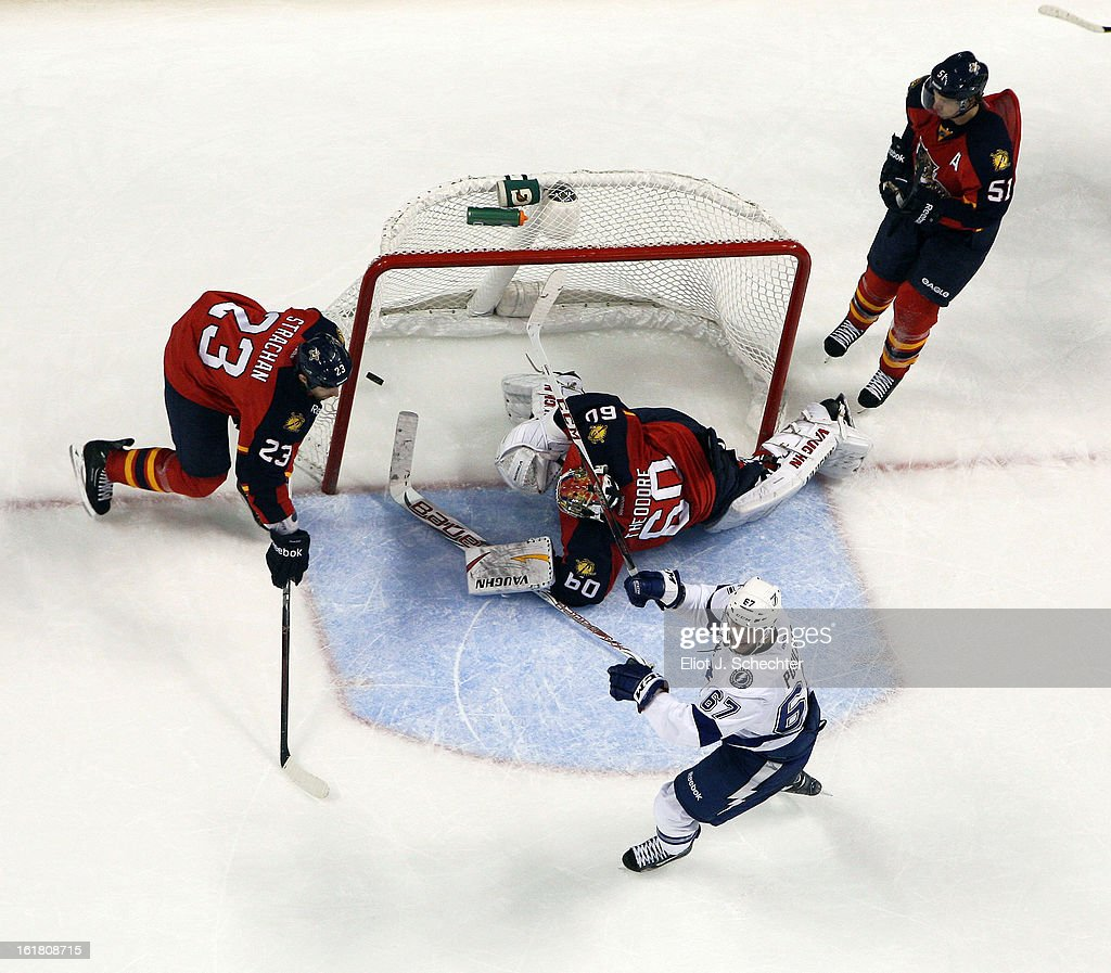 <a gi-track='captionPersonalityLinkClicked' href=/galleries/search?phrase=Benoit+Pouliot&family=editorial&specificpeople=879830 ng-click='$event.stopPropagation()'>Benoit Pouliot</a> #67 of the Tampa Bay Lightning shoots and scores the game winning overtime goal against Goaltender Jose Theodore #60 of the Florida Panthers at the BB&T Center on February 16, 2013 in Sunrise, Florida.